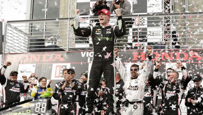 IndyCar Series driver Josef Newgarden (2) celebrates after winning the Honda Indy Grand Prix of Alabama at Barber Motorsports Park.