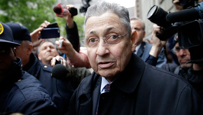 In this May 3, 2016, file photo, former New York Assembly speaker Sheldon Silver is surrounded by media as he leaves the court in New York where he was sentenced to 12 years in prison on corruption charges. On Thursday, July 13, 2017, a federal appeals court overturned Silver's corruption conviction, saying the judge's instructions on law weren't consistent with a recent Supreme Court ruling.