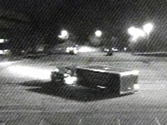 Video surveillance shows two trucks and trailers exiting a storage area on Tabor Road.