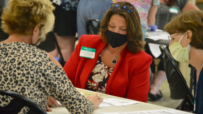 Allegan County Prosecutor Myrene Koch examines a ballot with poll workers Wednesday, Sept. 2, at Allegan Township Hall. Mike Villar challenged the Republican primary results after he lost by 19 votes to Koch.