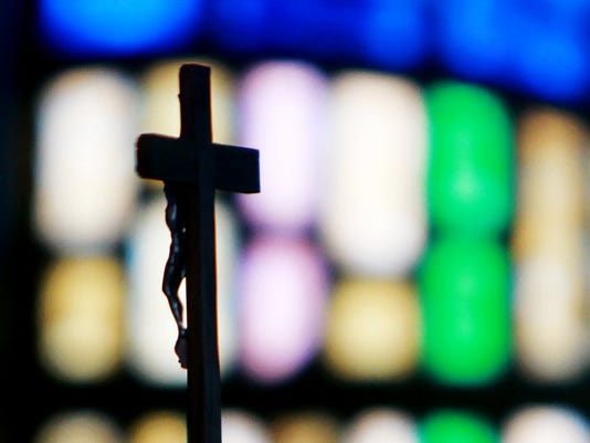 A cross is seen inside St. Mary's Catholic Church on Thursday in Farmington. The church is part of the Diocese of Gallup.