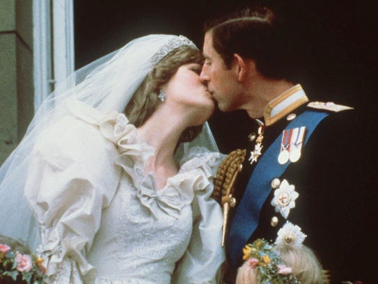 Britain's Prince and Princess of Wales kiss on the