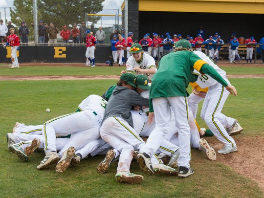 The Bishop Manogue team dog piles as they celebrate their win over Reno in the NIAA 4A Northern Regional Baseball Championship at Galena on  May 12.