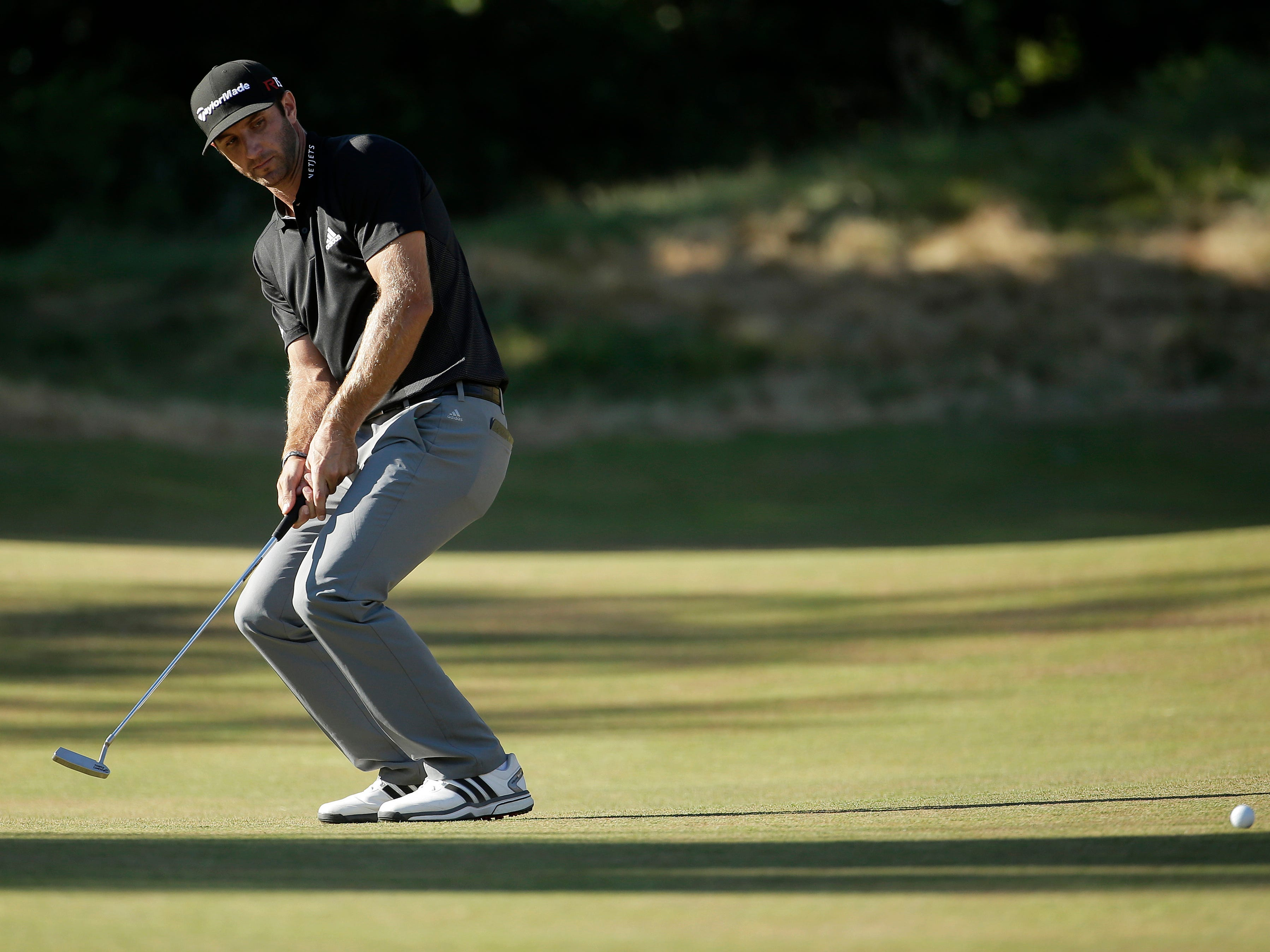 Dustin Johnson reacts to his putt on the 12th hole during the second round of the U.S. Open golf tournament at Chambers Bay on Friday, June 19, 2015 in University Place, Wash. (AP Photo/Charlie Riedel)