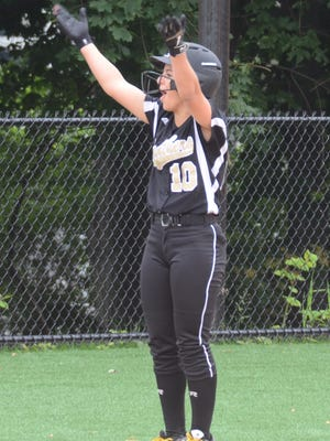 Cedar Grove's Ava Mandala celebrates on third base after her leadoff triple in the third inning.