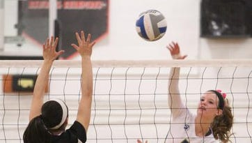 Nanuet's Sarah Zazyczny tries to block Ardsley's Casey Foley during their Class B Section 1 volleyball final at Croton-Harmon Saturday. Ardsley won the match in three games.