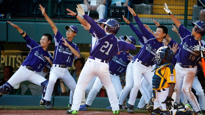 South Korea's Hae Chan Choi (21) celebrates with teammates after hitting a two-run home run off Chicago's Brandon Green in the sixth inning of the Little League World Series championship game in South Williamsport, Pa., on Sunday.
