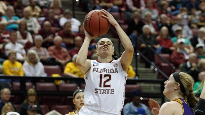 Florida State senior guard Brittany Brown (12) drives for a shot during her team's 87-66 victory over Western Illinois in the opening round of the NCAA Tournament on Friday night at the Tucker Center.