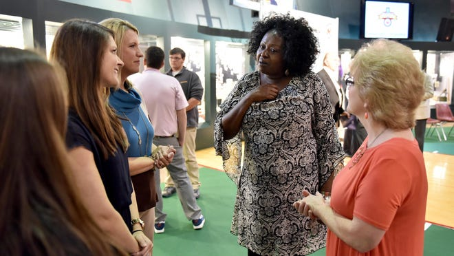 Tina Holder (center), sister of deceased Mississippi Sports Hall of Fame and Muesum 2016 inductee Willie Heidelberg, speaks to representatives of the Purvis Middle school class, who's project that helped get her brother inducted, following the announcement Monday at the museum in Jackson.