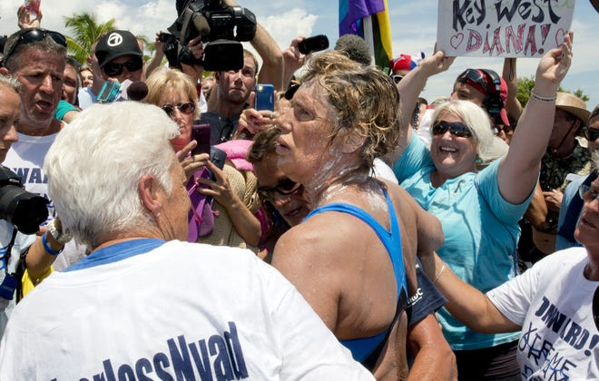 Diana Nyad, right, is supported by a longtime team member after completing a 111-mile swim from Cuba to Key West.
