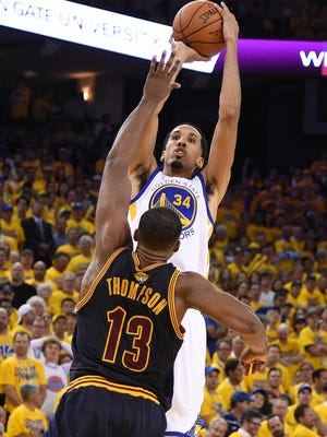 Golden State Warriors guard Shaun Livingston (34) shoots a basket against Cleveland Cavaliers center Tristan Thompson (13) during the second half in game one of the NBA Finals.