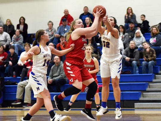 Sheridan's Mikayla Rhodes pulls down a rebound during