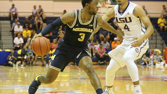 Michigan guard Zavier Simpson (3) tries to get past LSU guard Skylar Mays (4) during the first half in the Maui Jim Maui Invitational on Monday, Nov. 20, 2017, in Lahaina, Hawaii.