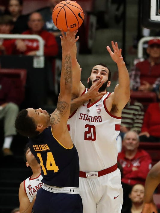 Stanford center Josh Sharma (20) blocks a shot by California guard Don Coleman (14) during the first half of an NCAA college basketball game Saturday, Dec. 30, 2017, in Stanford, Calif. (AP Photo/Tony Avelar)