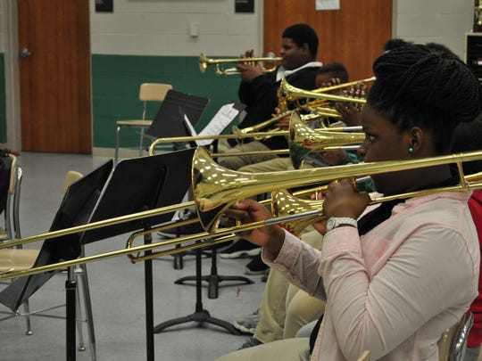 Willneisha Brown, a seventh-grader at Arthur F. Smith Middle Magnet School, practices her trombone Thursday at the Bontempian Big Band's final rehearsal of the week. The 20-piece ensemble will open Saturday's Jazz on the River concert, which has been moved to the Alexandria Riverfront Center.
