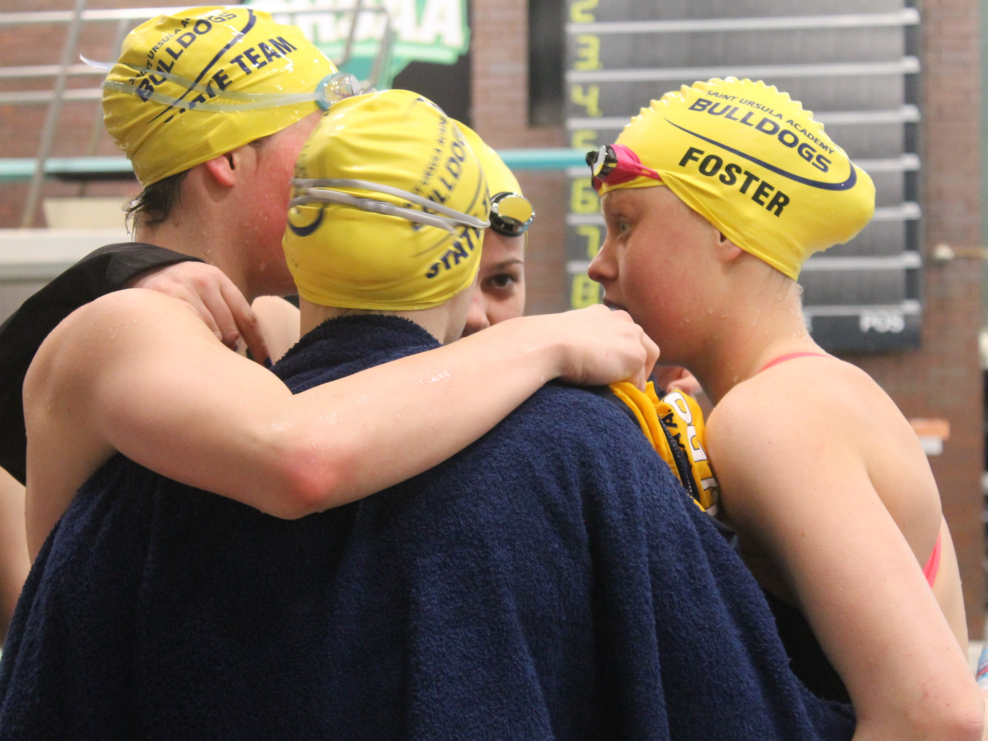 St. Ursula freshman Hannah Foster talks to her teammates before the 400 freestyle.