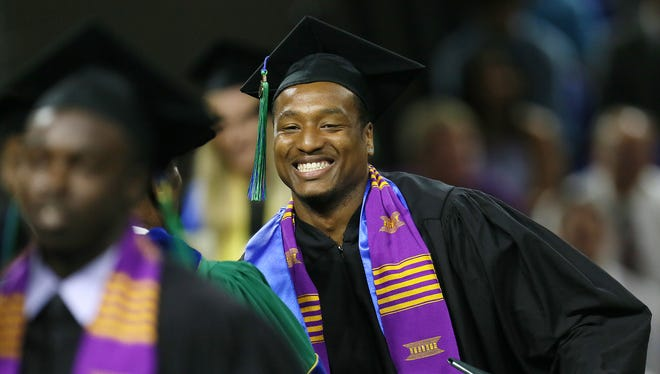 FILE PHOTO - May 2016 Graduation: Brian Greene Jr. was among those graduating Sunday from Florida Gulf Coast University at Alico Arena in Fort Myers. More than 1,600 students were awarded degrees.