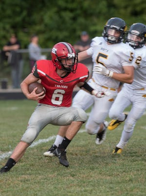 It was Tim Shaw's night off the field at Clarenceville, but Kyle Nolan (6) had a pretty good night on it against Lutheran North. Here he avoids tacklers. Nolan scored both of the Trojans TDs in a 42-13 defeat.