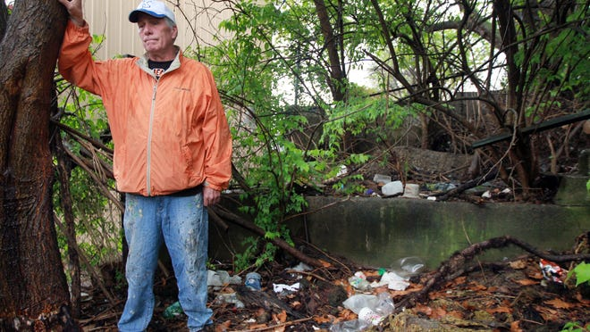 Michael Brosmore, a candidate for Covington City Commission, found needles used by drug addicts in an overgrown area near 12th and Wheeler streets. He's worried because kids play near there, and he wants the city to clean up the property. City officials say they don't have the right to clean up private property.