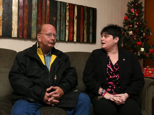 Scott MacArther talks with Regina Lassebe, program manager at Oak Place crisis home in Centerville on Tuesday. Since finding help with the Centerville Community Betterment, MacArther, who suffers from mental illness, has made significant improvements in his life.