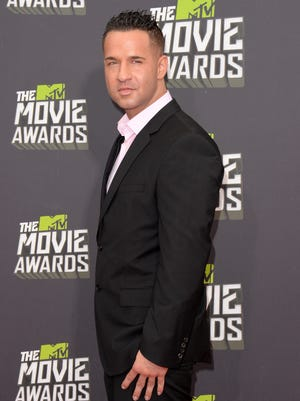 """Mike """"The Situation"""" Sorrentino arrives at the 2013 MTV Movie Awards at Sony Pictures Studios on April 14, 2013 in Culver City, California."""