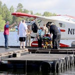 A camper is attended to by ambulance staff after arriving, July 21, 2016 in Ely, Minn., by floatplane from the Boundary Waters Canoe Area Wilderness after being injured in a violent storm. 01