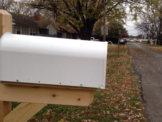The Springfield postal service  required curbside mailboxes
