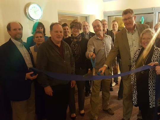 Community Tax & Accounting marked the move to its new office at 501 N. Eighth St., in Sheboygan, with the ribbon cutting Nov. 21. Pictured with Sheboygan County Chamber Executive Director Betsy Alles and state Rep. Terry Katsma are John Williams, Rick Gaumer and Steve Podewils cutting the ribbon.