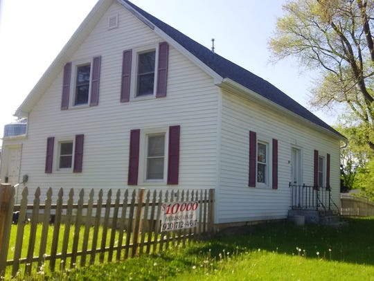 This is the way the house looked at 217 N. Wall St.