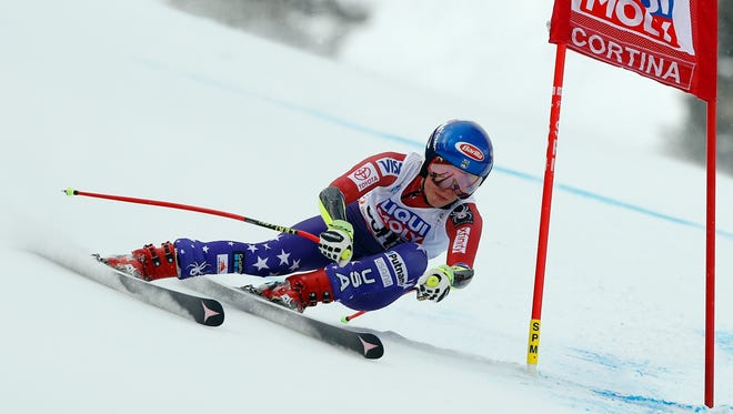FILE - In this Sunday Jan. 21, 2018, file photo, United States' Mikaela Shiffrin speeds down the course during the women's World Cup super-G ski race in Cortina D'Ampezzo, Italy. Past Olympic gold medalists Lindsey Vonn, Mikaela Shiffrin, Ted Ligety and Andrew Weibrecht are among the 22 ski racers named to the U.S. Alpine team heading to the Pyeongchang Games. (AP Photo/Gabriele Facciotti, File)