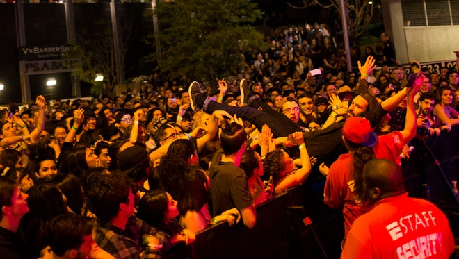 A crowd surfer floats during Neon Indian's set during the VIVA PHX music festival on Saturday, March 12, 2016, in Phoenix, Ariz.