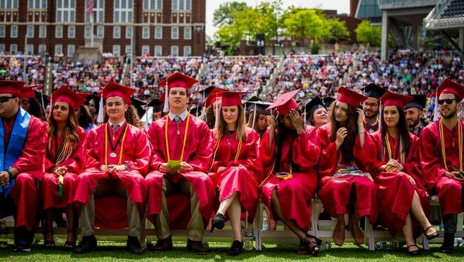 More than 6,100 students graduate from the University of Cincinnati at Nippert Stadium Saturday, April 29, 2017.