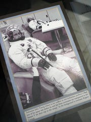 A picture shows astronaut John Young wearing an ILC