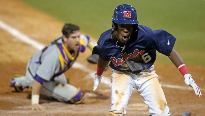 Shortstop Errol Robinson celebrates after scoring a run against LSU last weekend. Ole Miss is hoping to host a regional with this weekend's series against Georgia coming up.