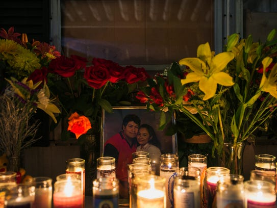 July 28, 2017 - Lit candles are placed in front of