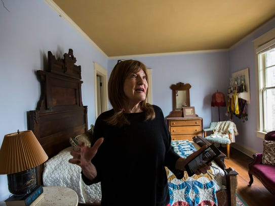 February 13, 2018 - Owner/agent Angie Kirkpatrick gives a tour of a 117-year-old house that's for sale at 1650 N. Parkway. The home was built by Judge Frank M. Guthrie.