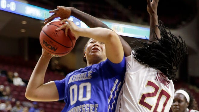 MTSU's Alex Johnson (00) is fouled by Florida State's Shakayla Thomas (20) during the NCAA Tournament first round in College Station, Texas, on March 19, 2016.