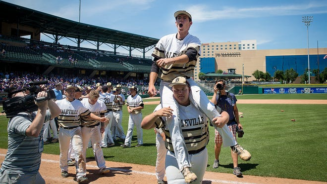 Daleville's Brandon Vermillion celebrates after defeating Lanesville in the state championship game at Victory Field Saturday.