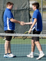 Oshkosh West's No. 1 doubles team, Aaron Jorgensen and Matt Jorgensen, slap hands as they play against Neenah on April 25.