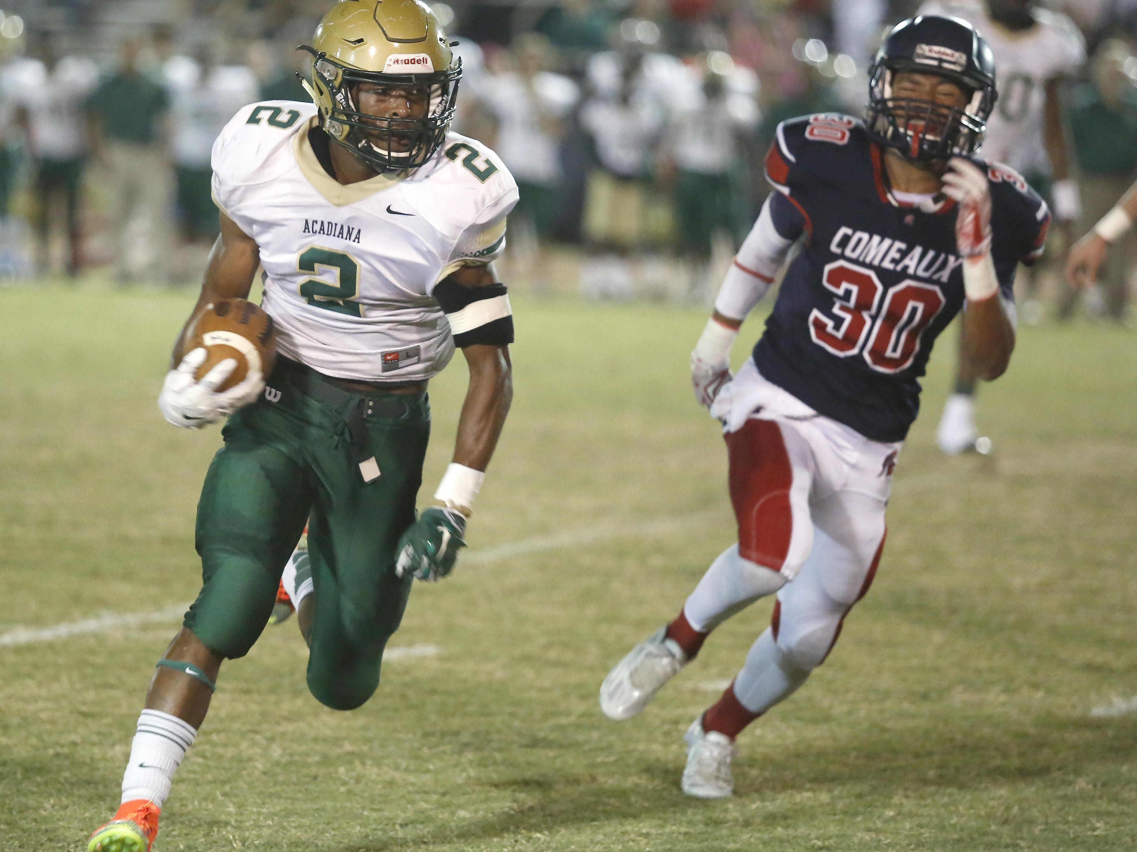 Acadiana High's Jayrin Wilson (2) runs around the corner of the Comeaux defense in Friday's win.