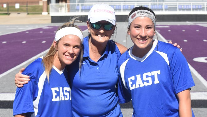 Former Lady Bomber soccer players Jessica Johnson (left) and Hope Menendez (right) joined Lady Bombers head coach Debbie Atkinson on the East team Friday night at the AHSCA's All-Star Games in Conway.