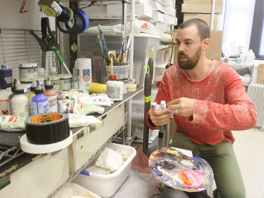 Artist Zac Skinner at work in his studio space in an