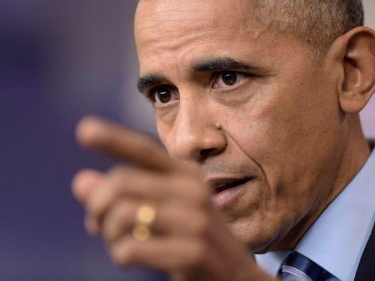 President Barack Obama speaks during a news conference,