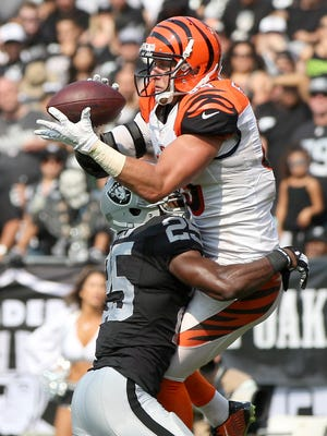 Cincinnati Bengals tight end Tyler Eifert (85) catches his second touchdown in the third quarter during the NFL football game between the Cincinnati Bengals and Oakland Raiders, Sunday, Sept. 13, 2015, at O.co Coliseum, in Oakland, California.