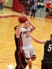 Ankeny's Conor Riordan (23) drives in for a lay up