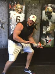 Houston Texans star J.J. Watt poses beside an image of his teammate Andre Hal, a former Vanderbilt standout, while visiting campus Wednesday.
