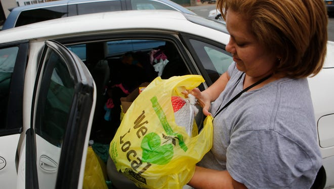 Jeannette Meneses of Spring Valley holds a turkey she got from the food pantry at People to People in Nanuet on Nov. 18, 2015.