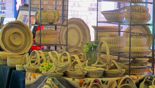Sweetgrass baskets woven by the descendants of slaves along the nation's Southeast coast are offered for sale at the City Market in Charleston, S.C., on April 23, 2015.