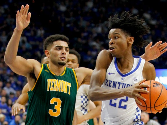 Former Greece Athena star Anthony Lamb, left, leads the Vermont Catamounts in scoring (15.6 points per game) and rebounding (5.8).