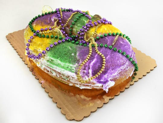A ring of sweet bread glazed and sprinkled with purple, green and yellow sugar is the must-eat Mardi Gras treat.